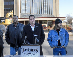 Matt Bartolo of Local 165 explains why the union worked on behalf of Warren Little, left, and Juan Goode in a dispute over payment for work for NMR Renovations of California at job site at former Sheraton Four Points hotel in Peoria.