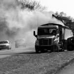 Toxic coal ash dust billows over northbound vehicles and nearby homes during cleanup following a crash on Illinois Route 29 that closed the southbound lanes for hours. A semi-trailer truck transporting coal fly ash crashed with a garbage truck on March 27. Photo by Clare Howard