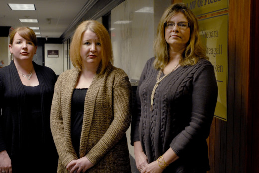 PHOTO BY CLARE HOWARD Plaintiffs Julie Boesch, Renee Boesch and Laura Broadstone, from left, standing outside the Peoria office of their attorney Richard Steagall who filed a sexual discrimination lawsuit in November against Sherman's Place in U.S. District Court in Peoria.