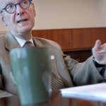 PHOTO BY CLARE HOWARD  Dr. Bento Soares gestures during a discussion in his office at University of Illinois College of Medicine at Peoria. His research is focused on genetics, epigenetics and cancer with special emphasis on cognitive compassion care, pediatric brain cancer and the impact of diet on prostate cancer development.