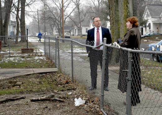 PHOTO BY CLARE HOWARD Andrew Hale and Marcella Teplitz continue to examine the evidence leading to the arrest and murder conviction of Cleve Heidelberg. They stand in front of the yard on Butler Street where Heidelberg was arrested 45 years ago, and they see too many inconsistencies that should have ruled Heidelberg out as a suspect. Up the street several blocks is the scene of the crash where Heidelberg's car hit a parked vehicle during a high-speed police chase.