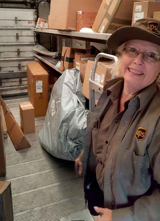 PHOTO BY BILL KNIGHT UPS driver Carol Steffen is retiring after decades of serving downtown Peoria and Main Street.
