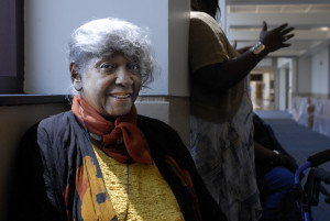 Mae Winston, 77, sits outside the courtroom waiting for July 28 hearing to review murder conviction of her brother Cleve Heidelberg. She was in court again for his hearing Sept. 22, but her health is declining.
