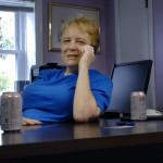 Peg Phillips is back in her office following a four-week illness with C. diff, an antibiotic resistant bacterial infection that is potentially deadly.