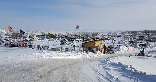 "A banner ""Enbridge Lies.com"" is posted at the entrance to the encampment at Standing Rock where hundreds of protesters are staying in yerts, tepees, tents, campers and sheds despite 45 degree below zero wind chills. Enbridge is one of the partners in the pipeline project that crosses Indian lands and under the Missouri River."